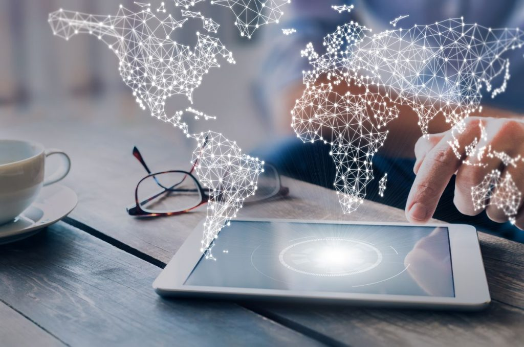 The world map network emerges above the tablet